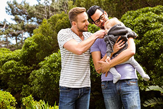 male couple and baby